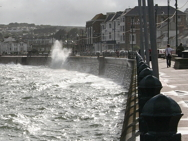 Sea breaking on promenade